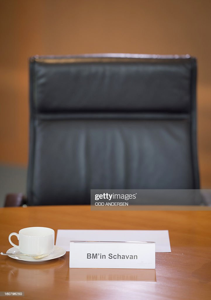 An empty chair is seen behind the name tag of German Education minister Annette Schavan prior to the weekly cabinet meeting lead by German Chancellor Angela Merkel at the Chancellery in Berlin on February 6, 2013. Germany's education minister and a close ally of Chancellor Angela Merkel was fighting for her political life Wednesday after having her doctorate revoked for plagiarism.