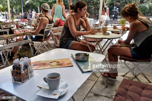 An empty coffee cup sits on a table outside a cafe on July 20 2015 in Athens Greece Many restrictions on bank transactions have remained in place and...