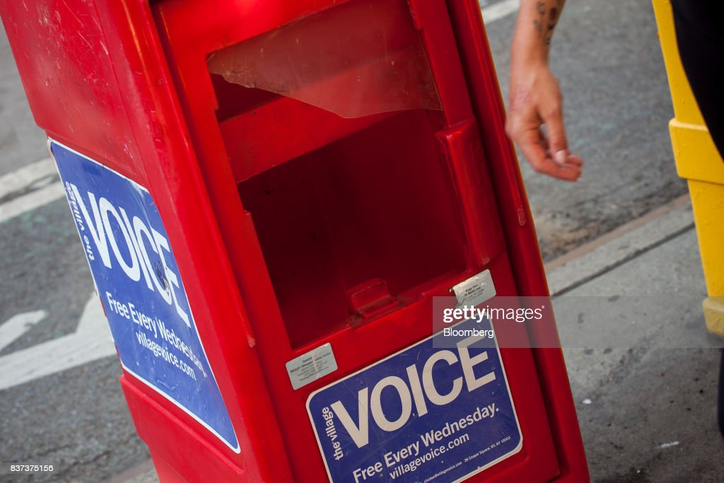 An empty distribution box for The Village Voice is seen in the East Village neighborhood of New York, U.S., on Tuesday, Aug. 22, 2017. Peter Barbey, owner of The Village Voice since 2015, has decided to no longer produce a print edition of the alt-weekly publication. The company's announcement, made Tuesday afternoon, came as a surprise, a shock and a disappointment to the larger media industry on Twitter. Photographer: Michael Nagle/Bloomberg via Getty Images