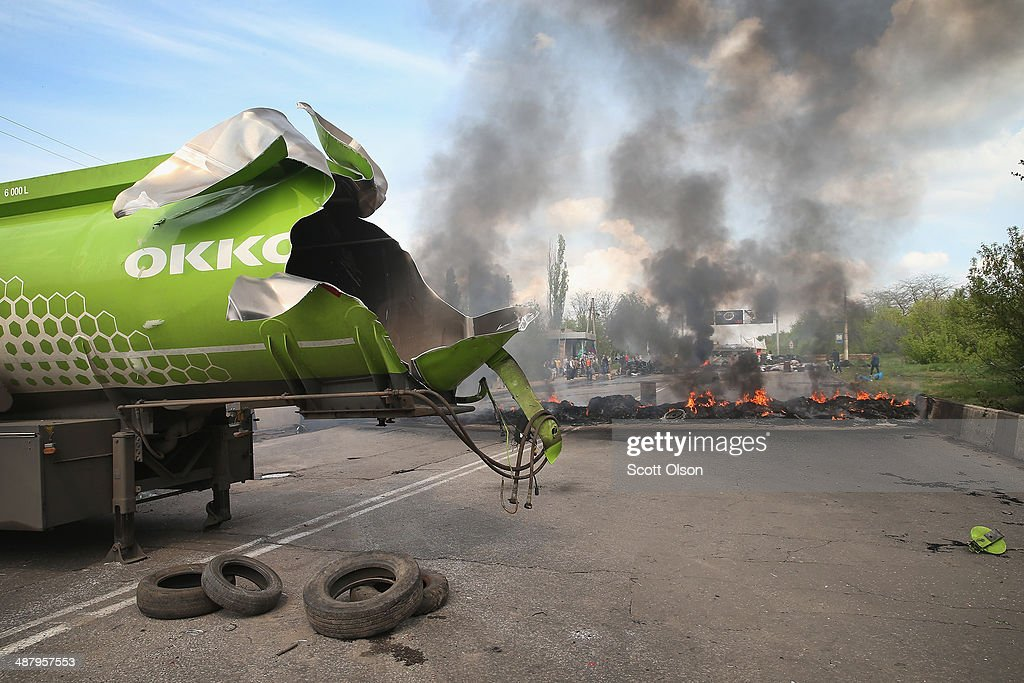 An empty fuel tanker being used by pro-Russian activist to block a road exploded after it was fired on during an assault by the Ukrainian army on May 3, 2014 in Kramatovsk, Ukraine. Over the past couple of days the Ukrainian army has been assaulting pro-Russian checkpoints in and around Kramatovsk which sits on the edge of Slovyansk, a pro-Russian activist stronghold.