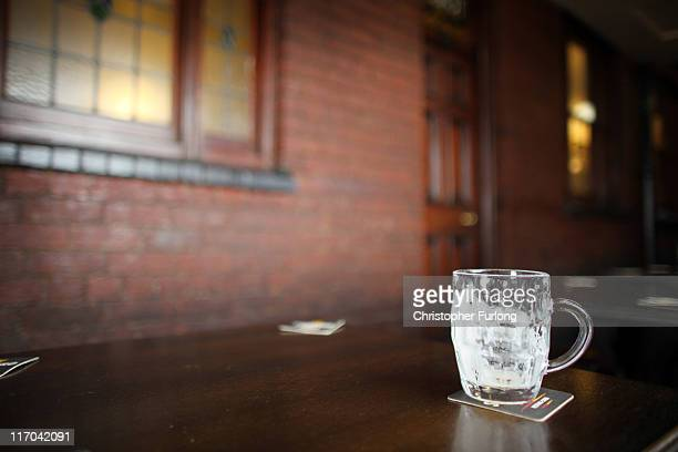 An empty glass sits ona table after being quickly drank by a regulars at the Bull and Bladder Pub a traditional Black Country establishment on June...