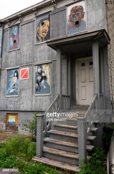 An empty home is decorated with portraits on May 30 in Newburgh New York Rows of boardedup homes became a ubiquitous symbol of the US housing crash...