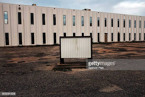 An empty office building sits downtown on January 3 2016 in Biloxi Mississippi According to the US Census Bureau Mississippi is the nation's poorest...