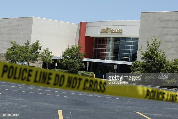 An empty parking lot if seen outside The Grand Theatre in Lafayette Louisiana on July 24 following a deadly shooting the night before A 'drifter'...
