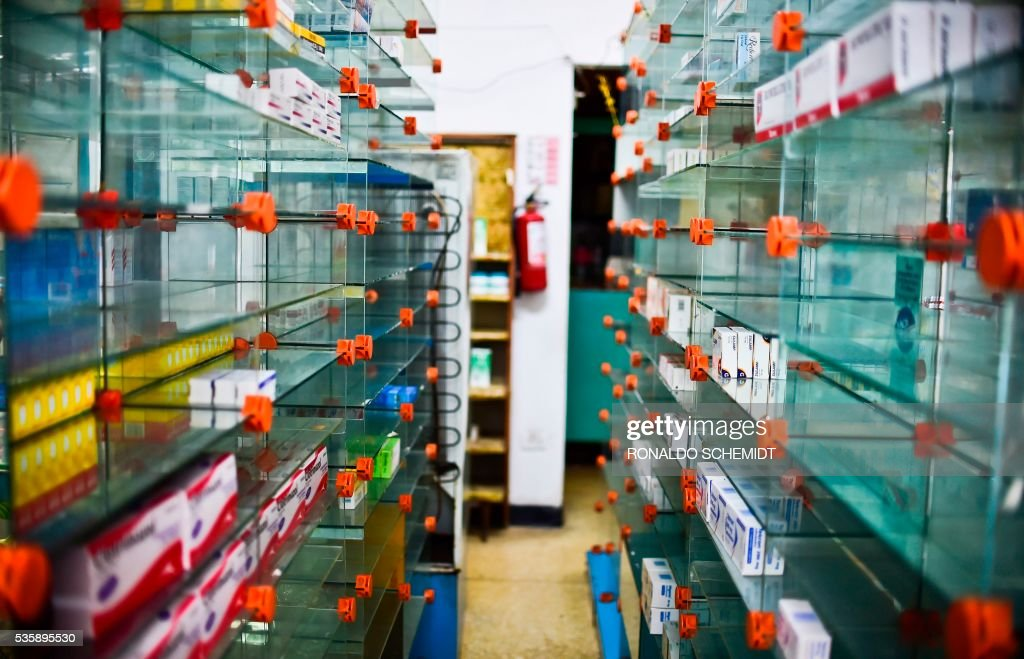 An empty pharmacy is pictured in Caracas on May 30, 2016. The shortage of medicines in Venezuela exceeds 85%, revealed the president of the harmaceutical federation of Venezuela, Freddy Ceballos. / AFP / RONALDO