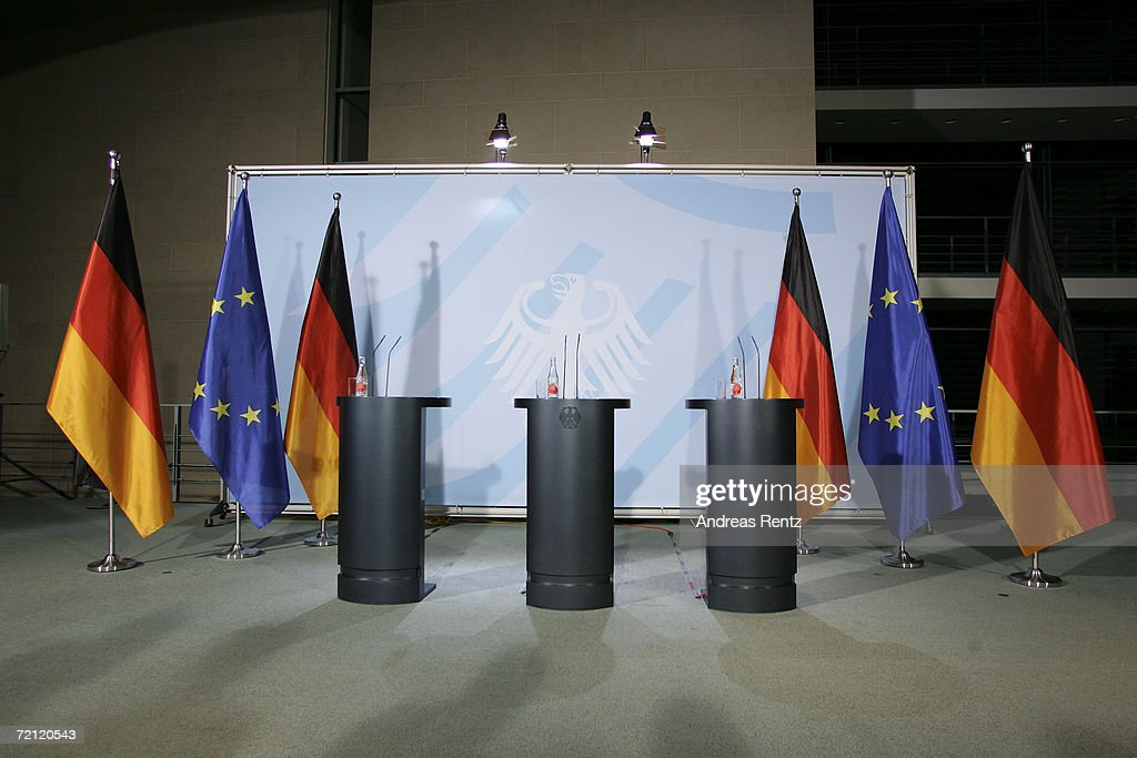 An empty podium is seen before German Chancellor Angela Merkel addresses the media in the early hours after a meeting at the Chancellery on October 5...