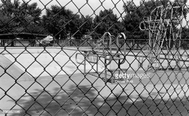 An empty pool at La Raza park sits abandoned behind the chain link fence Credit The Denver Post