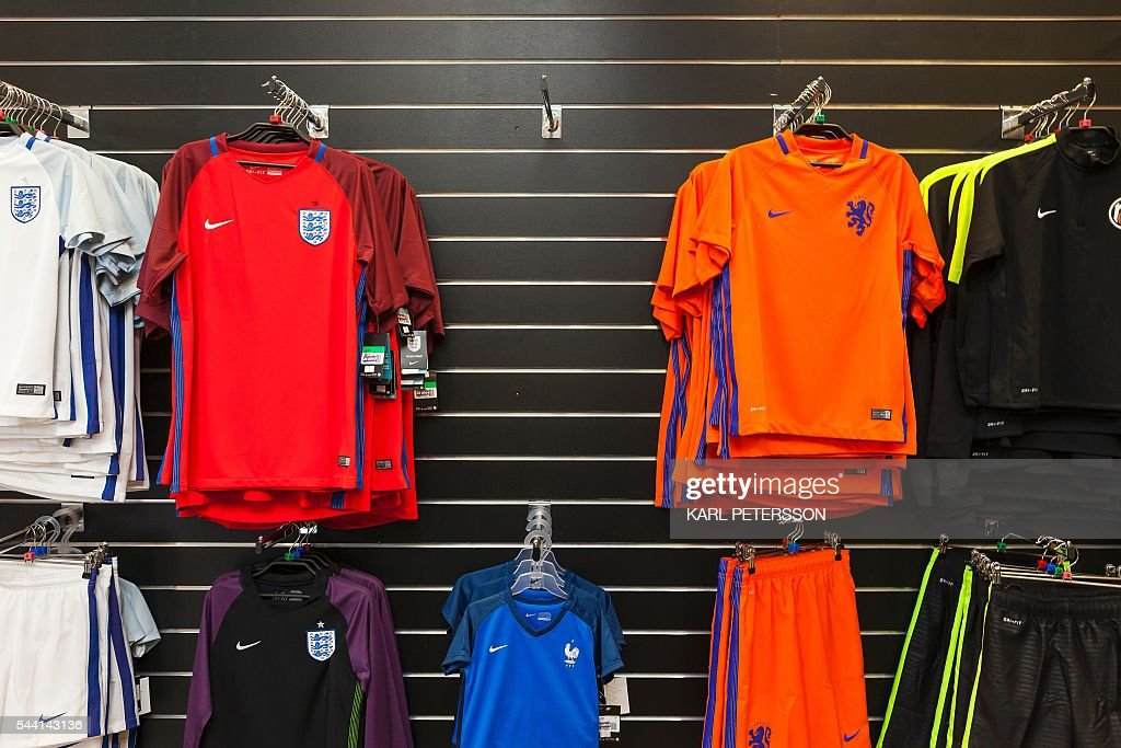 An empty rack where the Icelandic football jersey was sold are pictured in a shop in Reykjavik, on July 1, 2016. With a large part of its population in France for the Euro 2016, Iceland has pretty much come to a standstill except for its tourism sector, which is booming. / AFP / Karl Petersson