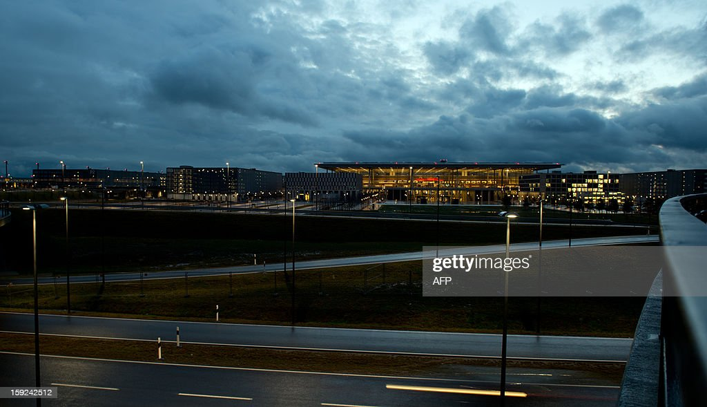 An empty road leads to the construction site of a terminal of the new 'Willy Brandt' Berlin Brandenburg International (BER) airport at dawn on January 10, 2013. The opening of the Berlin Brandenburg Willy Brandt (BER) airport has been postponed indefinitely after several previous delays, the city's mayor said early January 2013, in a fresh blow for the German capital and its top official.