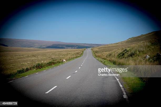An empty road snakes through the Brecon Beacons