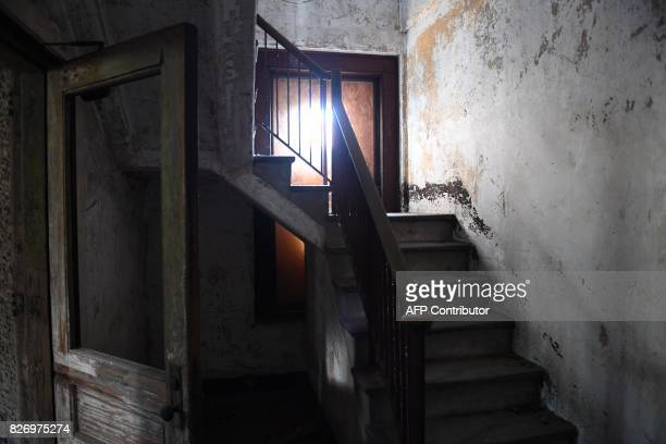 An empty room is seen in one of the buildings of the The Ellis Island Hospital on August 5 a 750bed facility which treated over 12 million patients...