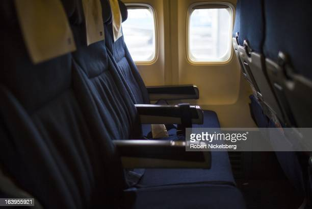 An empty row of seats is seen on a Scandinavian Airlines plane at the Oslo Airport Gardermoen February 27 2013 in Oslo Norway