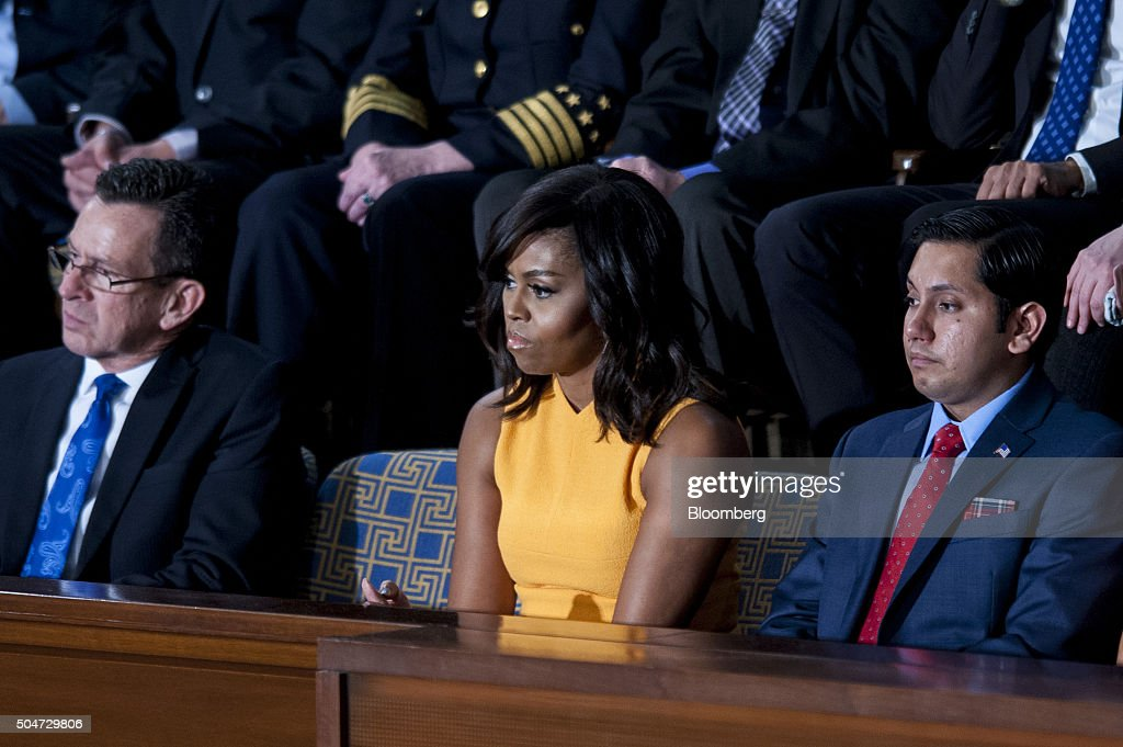 An empty seat in honor of victims of gun violence sits between Connecticut governor Dannel Malloy, left, and First Lady Michelle Obama, center, as U.S. President Barack Obama delivers the State of the Union address to a joint session of Congress at the Capitol in Washington, D.C., U.S., on Tuesday, Jan. 12, 2016. Obama said he regrets that political divisiveness in the U.S. grew during his seven years in the White House and he plans to use his final State of the Union address Tuesday night to call for the nation to unite Photographer: Pete Marovich/Bloomberg via Getty Images