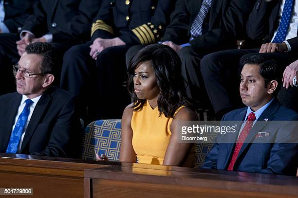 An empty seat in honor of victims of gun violence sits between Connecticut governor Dannel Malloy left and First Lady Michelle Obama center as US...