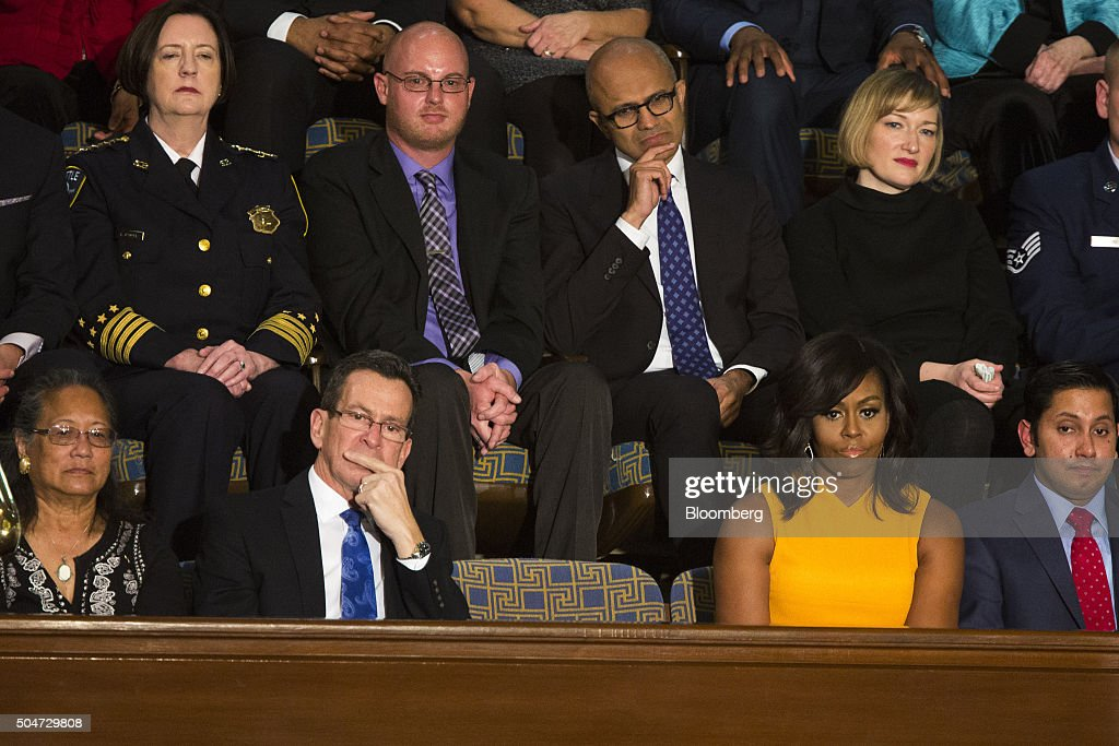 An empty seat in honor of victims of gun violence sits between Connecticut governor Dannel Malloy, front row second left, and First Lady Michelle Obama, front row second right, as U.S. President Barack Obama delivers the State of the Union address to a joint session of Congress at the Capitol in Washington, D.C., U.S., on Tuesday, Jan. 12, 2016. Obama said he regrets that political divisiveness in the U.S. grew during his seven years in the White House and he plans to use his final State of the Union address Tuesday night to call for the nation to unite Photographer: Pete Marovich/Bloomberg via Getty Images