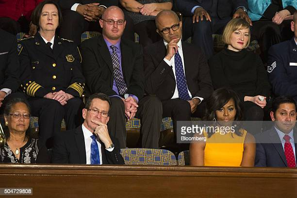 An empty seat in honor of victims of gun violence sits between Connecticut governor Dannel Malloy front row second left and First Lady Michelle Obama...