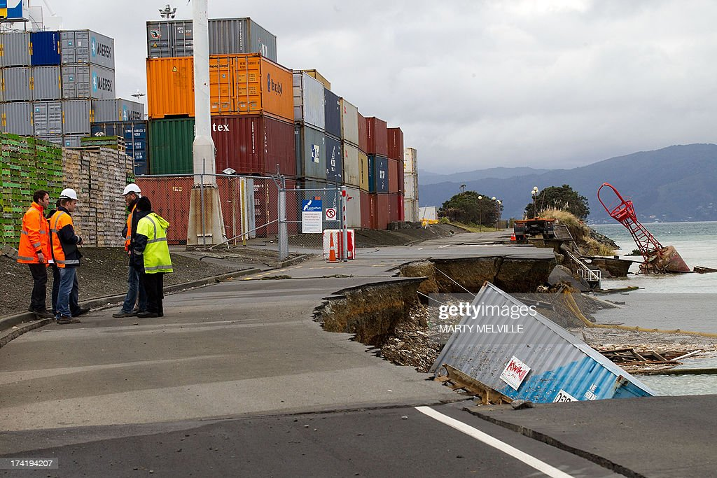 An empty shipping container sits in the harbour where the land fell into the sea at the Port Wellington Container terminal caused by yesterdays earthquake on July 22, 2013. Wellington city was hilt by a 6.5 magnitude earthquake on Sunday afternoon at 5.06pm on July 21 causing medium damage to the city. AFP PHOTO / MARTY MELVILLE