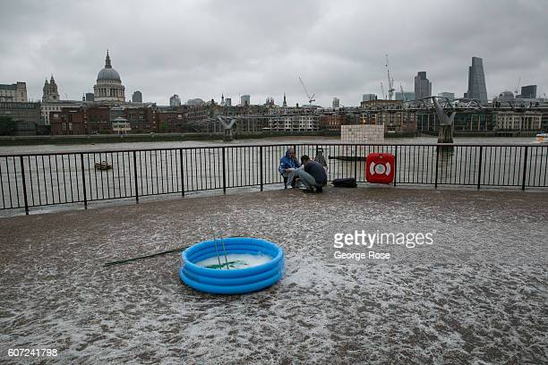 An empty swimming filled with soap suds is viewed outside the Tate Modern museum on September 11 in London England The collapse of Great Britain...