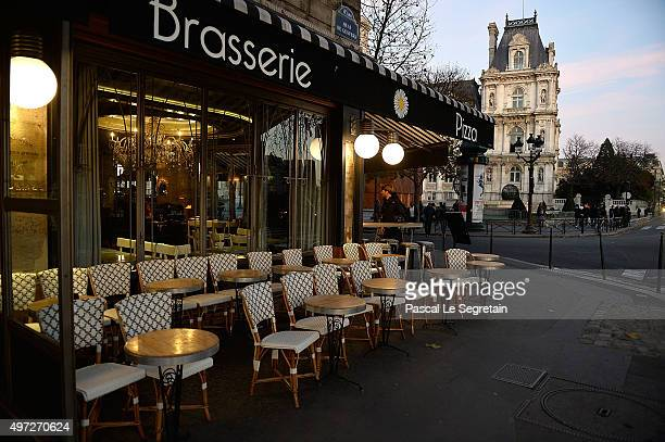 An empty terrace of a cafe is pictured on November 15 2015 in Paris France At least 129 people have been killed and over 200 injured 80 of which...