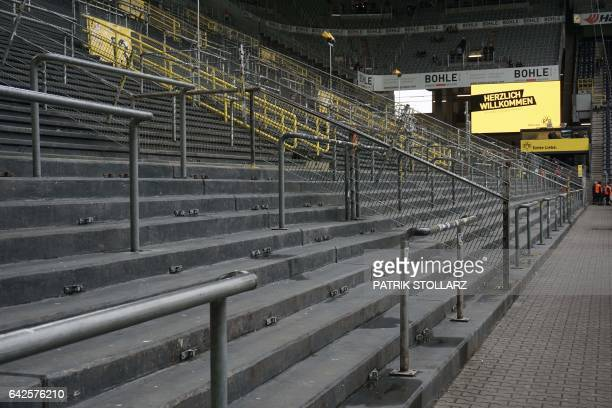 An empty tribune is seen prior to the German first division Bundesliga football match of Borussia Dortmund vs VfL Wolfsburg in Dortmund western...