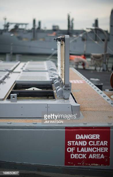 An empty vertical launching system aboard the Arleigh Burkeclass guided missile destroyer USS Stout at Naval Station Norfolk in Norfolk Virginia May...