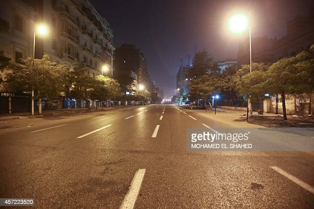 An empty view of the closed Ramses Street after the car explosion wounding 13 people security and medical officials said A police officer on the...