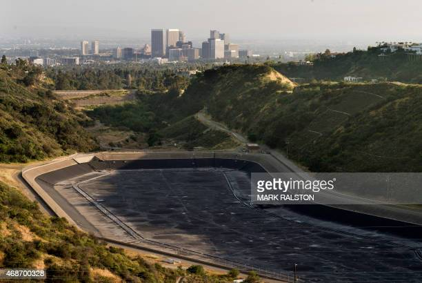 An empty water reservoir is seen in the hills above Los Angeles as a severe drought continues to affect the state of California on April 5 2015...