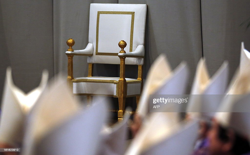 An empy papal throne lies prior the mass for Ash Wednesday, opening Lent, the forty-day period of abstinence and deprivation for the Christians, before the Holy Week and Easter, on February 13, 2013 at St Peter's basilica at the Vatican. Pope Benedict XVI made his first public appearance on Wednesday since his shock resignation announcement, asking thousands of cheering pilgrims at the Vatican to 'keep praying for me'. AFP PHOTO / POOL / ALESSANDRO BIANCHI