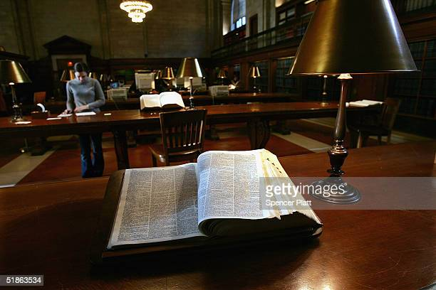 An encyclopedia stands open in the reading room at the New York Public Library December 15 2004 in New York City Google the internet search engine...