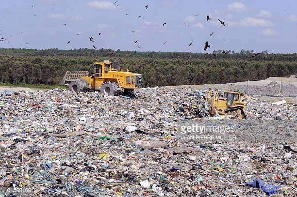 An engin collects rubbishs at the French 'Veolia Proprete' site of the waste storage centre on May 18 2010 in Lapouyade southwestern France The...