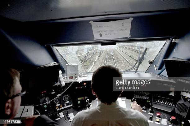 An engine driver operates in the cab during the inauguration ceremony of stateowned rail company SNCF third generation of France's Fast Speed Train...