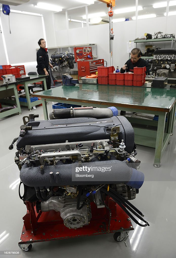 An engine for Nissan Motor Co. Nismo vehicles sits in the repair shop at the Nismo global headquarters and development center in Yokohama City, Japan, on Tuesday, Feb. 26, 2013. Chief Executive Officer Carlos Ghosn, who has called 100 yen to the dollar the 'neutral' value for the Japanese currency, said the yen should weaken further. Photographer: Akio Kon/Bloomberg via Getty Images