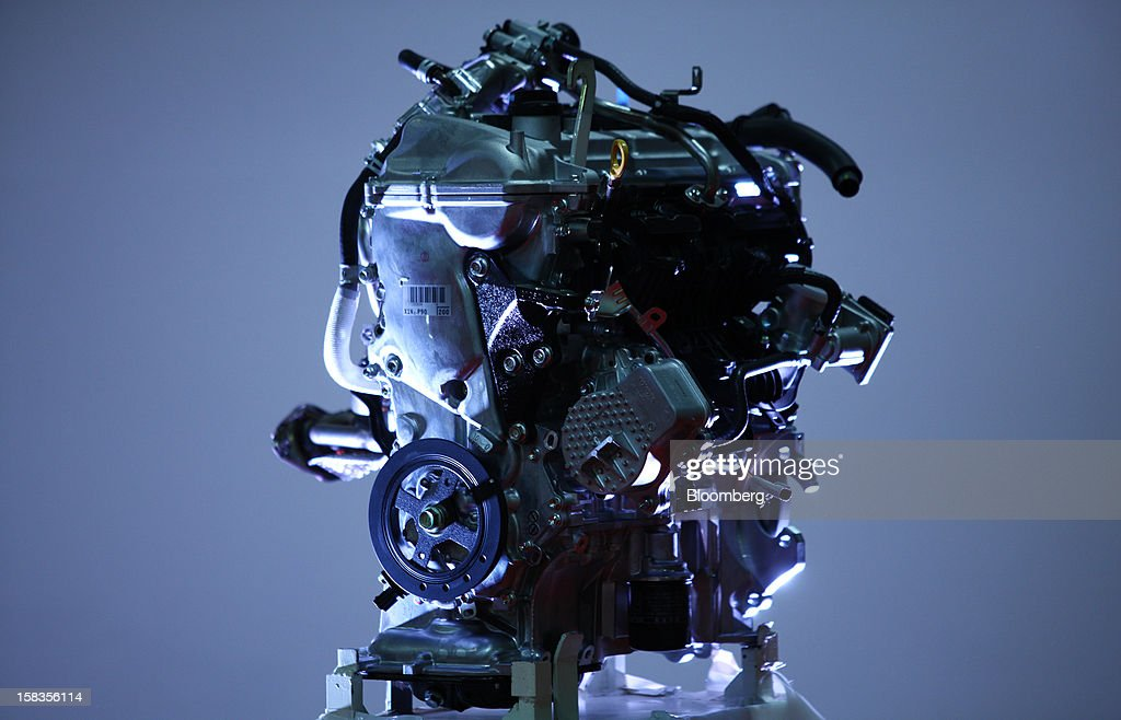 An engine for the Toyota Motor Corp. Aqua hybrid compact car is displayed after the line-off ceremony of Toyota Motor East Japan Inc.'s Miyagi Taiwa Plant in Taiwa, Miyagi Prefecture, Japan, on Friday, Dec. 14, 2012. Toyota Motor East Japan Inc. commenced operations at the plant today. Photographer: Tomohiro Ohsumi/Bloomberg via Getty Images