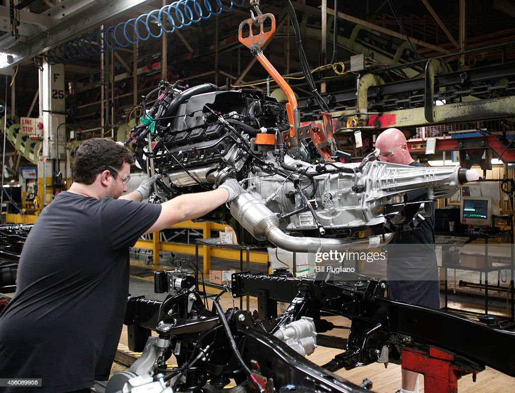 An engine is installed into a Chrysler Ram 1500 truck as it goes through the assembly line at the Warren Truck Assembly Plant September 25 2014 in...