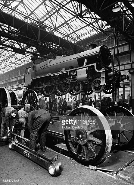 An engine is lifted for inspection at a London Midland and Scottish railway works