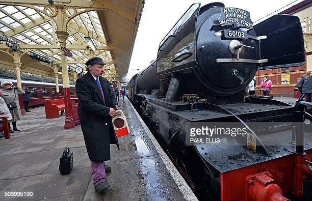 An engineer carries a lamp towards the front of The Flying Scotsman after it arrived at Bury Bolton Street rail station in Bury north west England on...