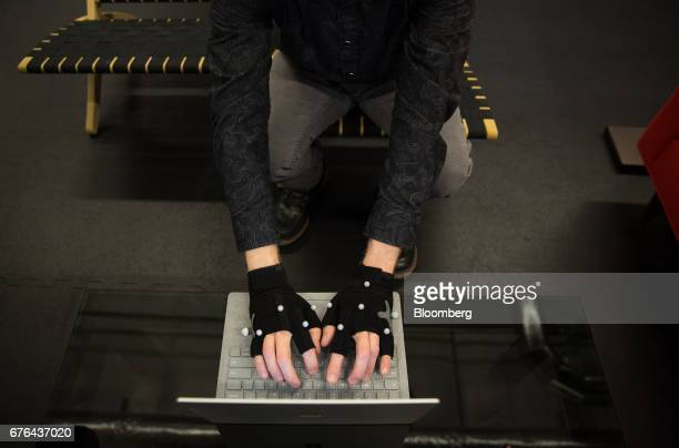An engineer demonstrates body motion tracking equipment at the human factors lab of the Microsoft Corp main campus in Redmond Washington US on...