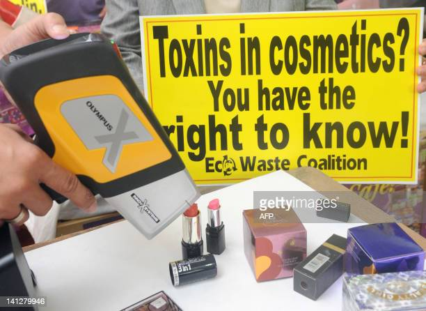An engineer from the chemical safety advocates EcoWaste Coalition checks cosmetics products for lead content using the xray fluorescence spectrometer...