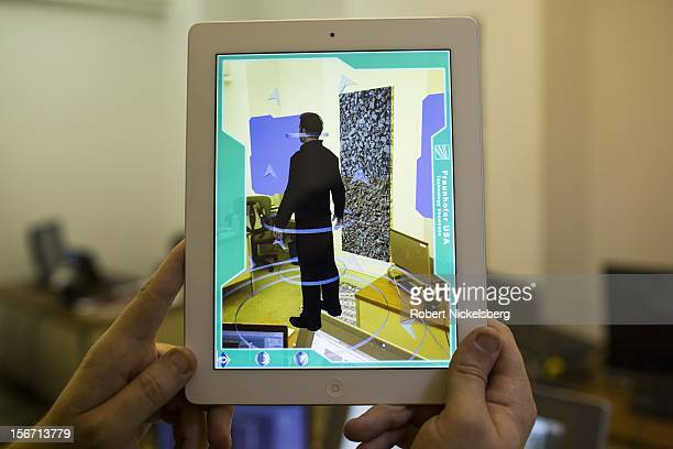 An engineer holds an iPad with an example of an interactive guide program called 'augmented reality' that will be installed in the new Fraunhofer...