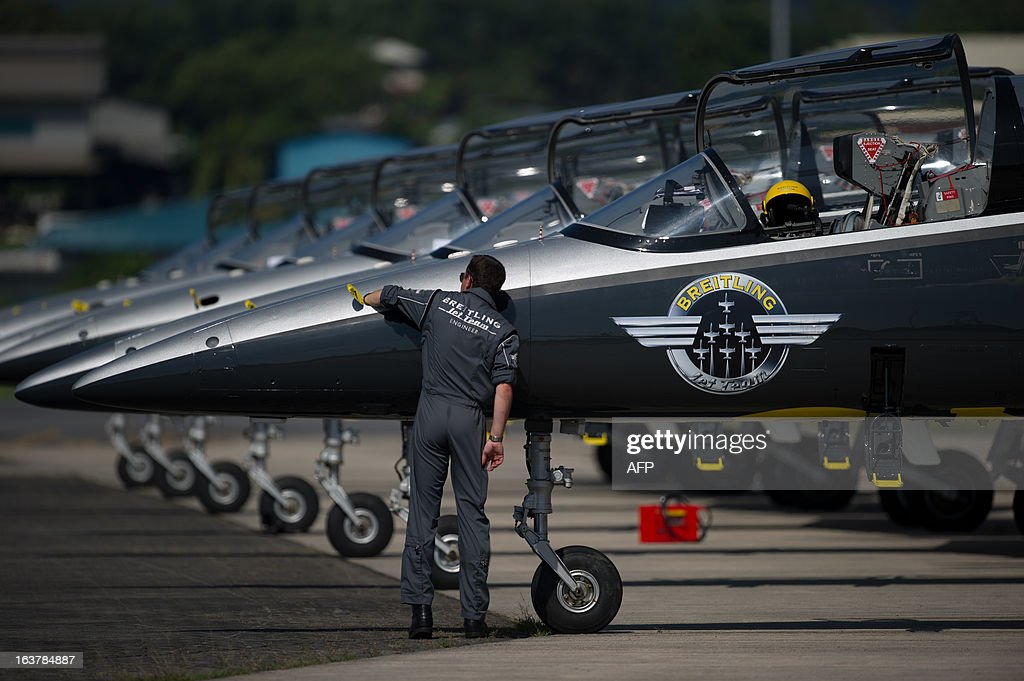 An engineer inspects a Breitling jet before performing an aerobatic display over Subang Skypark in Subang outside Kuala Lumpur on March 16, 2013. The Breitling jet team is in Malaysia as part of their Asian tour.