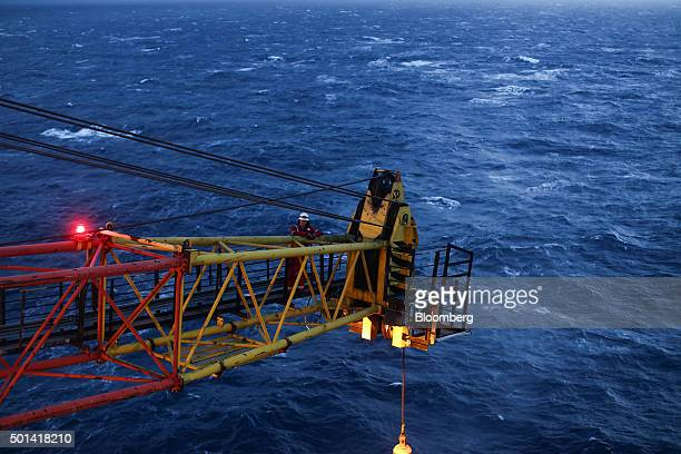 An engineer inspects a lifting crane on the Armada gas condensate platform operated by BG Group Plc in the North Sea off the coast of Aberdeen UK on...