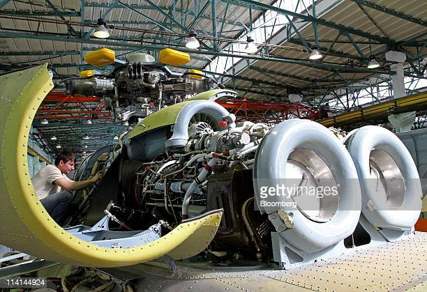 An engineer inspects the engine bay of a Mi17 helicopter at the JSC Kazan Helicopters factory operated by JSC 'Russian Helicopters' in Kazan Russia...