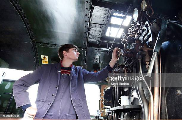An engineer look at gauges inside the engine of The Flying Scotsman during a test run along the East Lancashire line for the first time in ten years...