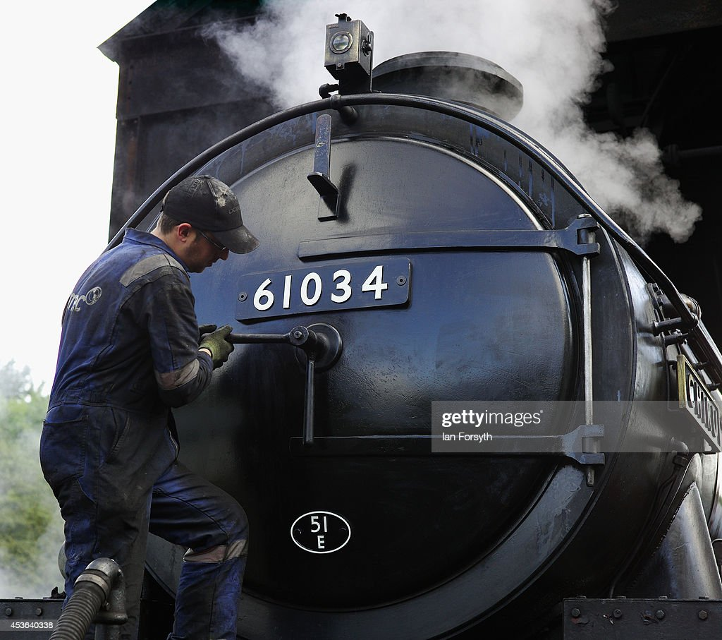 An engineer makes final checks to the locomotive 'Chiru' at Grosmont train engine sheds in preparation for the ceremony to mark a second platform opening at Whitby train station on August 15, 2014 in Whitby, England. The second platform will provide passengers with more options for travel to the Yorkshire seaside town on the North Yorkshire Moors Railway and was the first time in half a century two steam locomotives were side by side at the station.