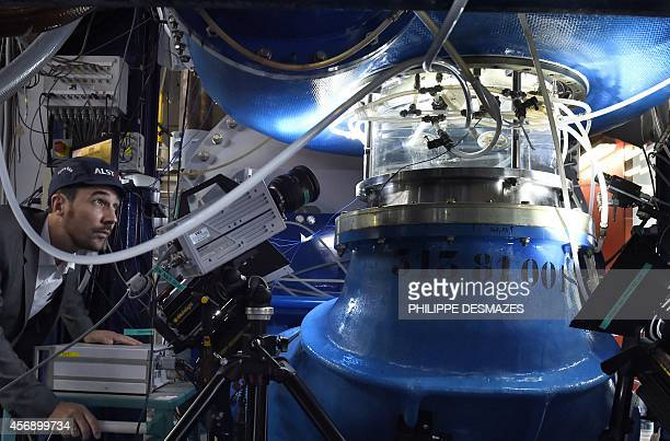 An engineer monitors a test of a pumpturbine at the Alstoms global technology and hydropower centre in Grenoble eastern France on October 8 2014 The...