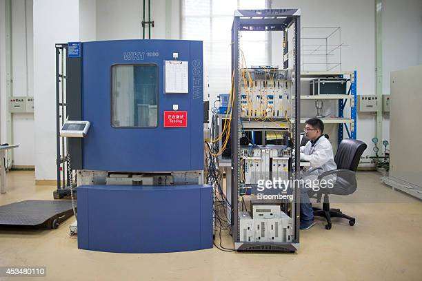 An engineer monitors testing conducted inside a Weiss Technik test chamber in the global compliance and testing center at the Huawei Technologies Co...