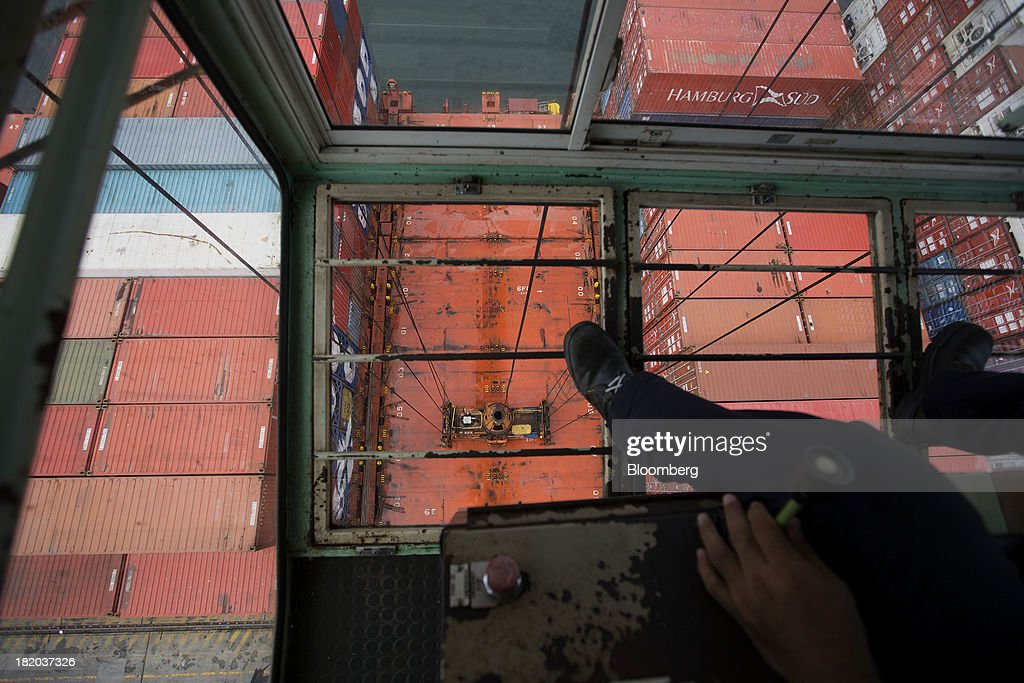 An engineer operates a port crane to lift a shipping container at the Port of Veracruz in Veracruz, Mexico, on Thursday, Sept. 26 2013. Mexico reported a preliminary trade deficit of $234.2 Million for August, according to the national statistics agency, known as Inegi. Photographer: Susana Gonzalez/Bloomberg via Getty Images