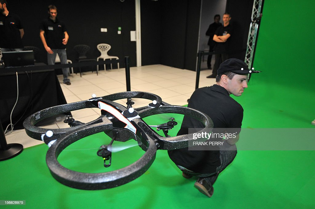 An engineer performs a demonstration of a drone used to previsualize camera effects during the inauguration of the Technicolor research and development centre in Cesson-Sevigne near the western city of Rennes on November 22, 2012.