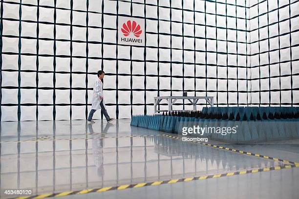 An engineer walks through a semianechoic chamber in the global compliance and testing center at the Huawei Technologies Co campus in the Longgang...