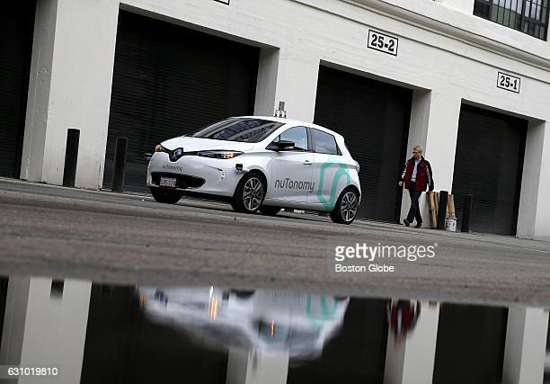 An engineer walks towards NuTonomy's driverless car the first to launch in Boston as he prepares to take it for a spin around Drydock Ave in South...